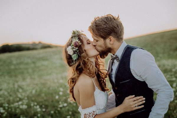 beautiful bride and groom at sunset in green PM8YVNS